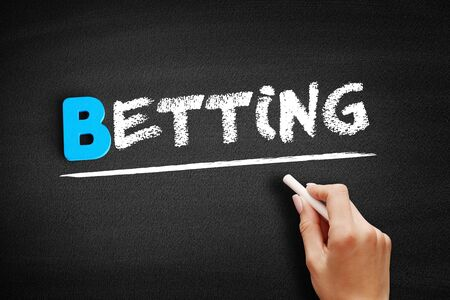 Betting text on blackboard, business concept background 스톡 콘텐츠