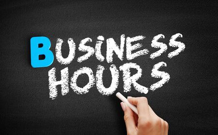 Business hours text on blackboard, business concept background Imagens