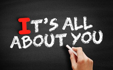 It's All About You text on blackboard, concept background Archivio Fotografico