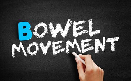 Bowel movement text on blackboard, concept background 写真素材 - 129748844
