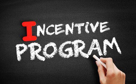 Incentive program text on blackboard, business concept background Zdjęcie Seryjne