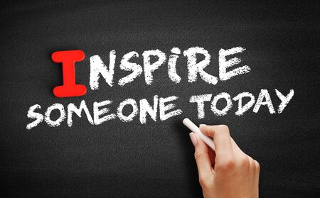 Inspire Someone Today text on blackboard, motivation concept background