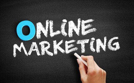 Online Marketing text on blackboard, business concept background