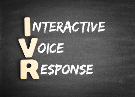 Wooden alphabets building the word IVR - Interactive Voice Response acronym on blackboard