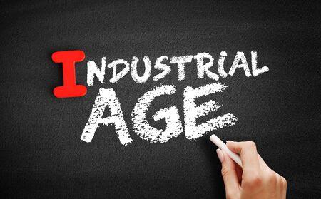 Industrial age text on blackboard, concept background Zdjęcie Seryjne