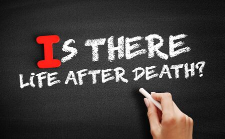Is There Life After Death? text on blackboard, concept background