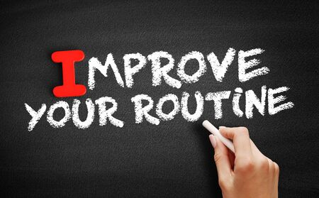 Improve Your Routine text on blackboard, business concept background