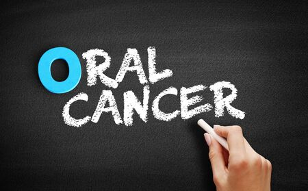 Oral Cancer text on blackboard, concept background