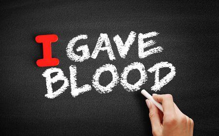 I Gave Blood text on blackboard, concept background Zdjęcie Seryjne
