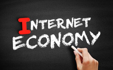 Internet economy text on blackboard, business concept background