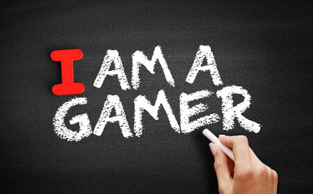 I Am a Gamer text on blackboard, concept background