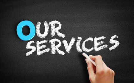Our Services text on blackboard, business concept background Reklamní fotografie