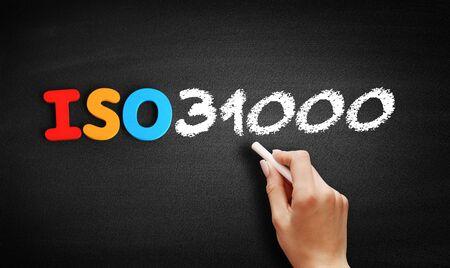 ISO 31000 international standard text on blackboard, concept background Stock fotó