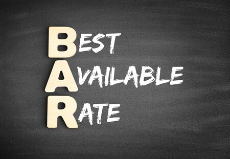 Wooden alphabets building the word BAR - Best Available Rate acronym on blackboard Stok Fotoğraf
