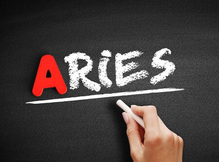 Aries text on blackboard, concept background Stock Photo