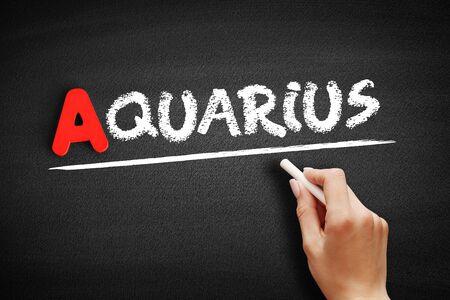 Aquarius text on blackboard, concept background