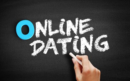 Online Dating text on blackboard, concept background