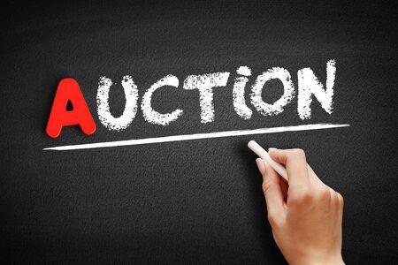 Auction text on blackboard, business concept background Stok Fotoğraf