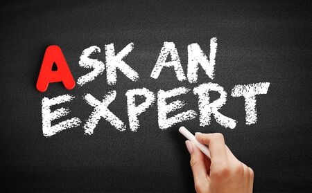 Ask an expert text on blackboard, business concept background 스톡 콘텐츠