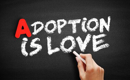 Adoption Is Love text on blackboard, concept background