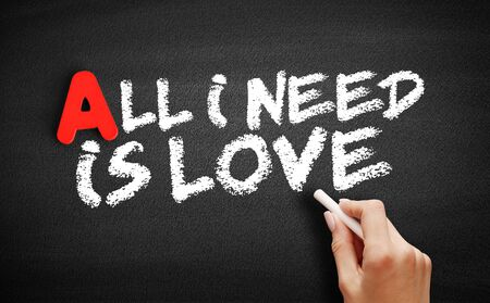 All I need is love text on blackboard, concept background Фото со стока