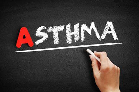 Asthma text on blackboard, medical concept background