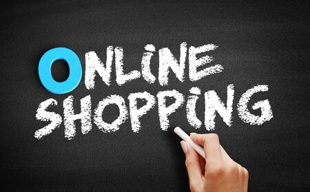 Online shopping text on blackboard, business concept background