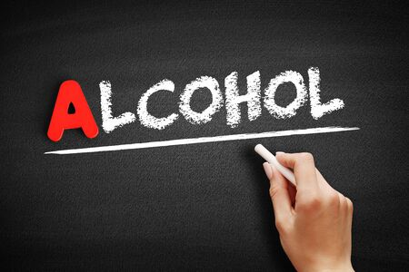 Alcohol text on blackboard, business concept background