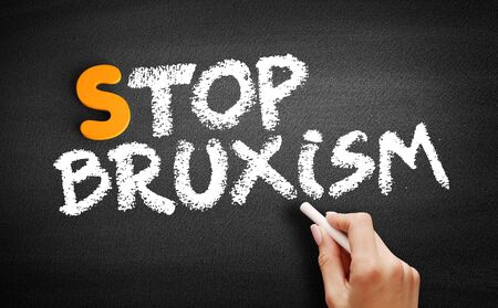 Stop Bruxism text on blackboard, concept background