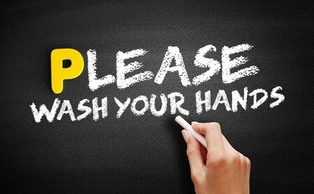 Please Wash Your Hands text on blackboard, concept background Banco de Imagens