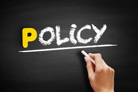 Policy text on blackboard, business concept background 스톡 콘텐츠