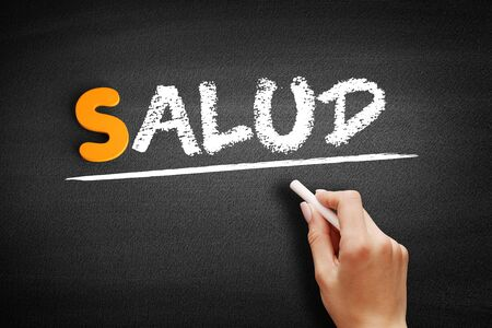 Salud (Health in Spanish) text on blackboard, concept background Stock Photo