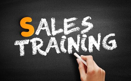 Sales Training text on blackboard, business concept background
