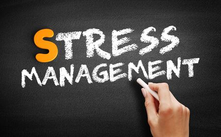 Stress Management text on blackboard, business concept background