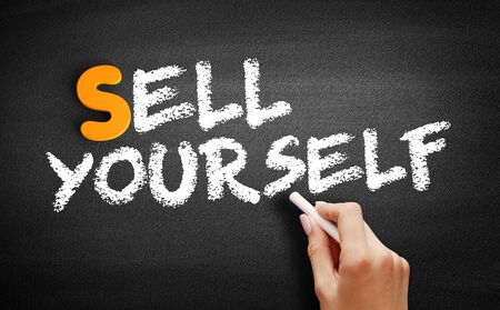 Sell Yourself text on blackboard, business concept background