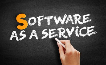 Software As A Service text on blackboard, business concept background Фото со стока