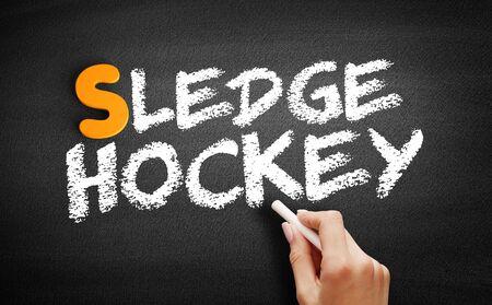 Sledge hockey text on blackboard, concept background