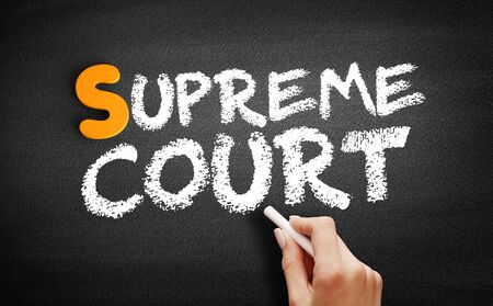 Supreme Court text on blackboard, concept background