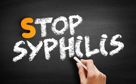 Stop Syphilis text on blackboard, health concept background Imagens