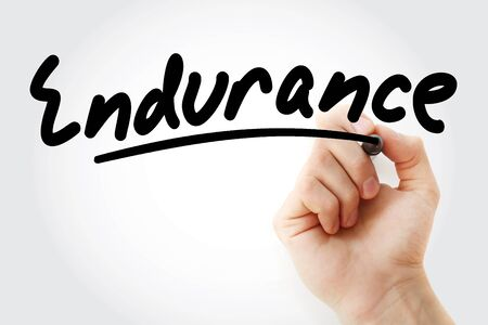 Hand writing Endurance with marker, health concept Stock Photo
