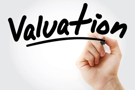 Hand writing Valuation with marker, concept background