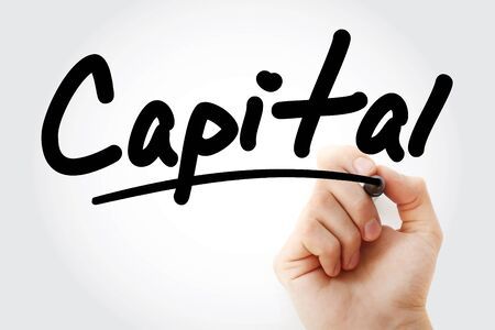 Hand writing CAPITAL with marker, business concept