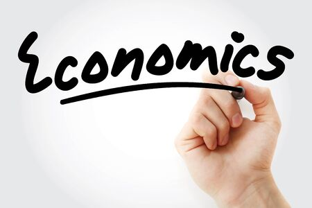 Hand writing ECONOMICS with marker, business concept Stock fotó - 131670998