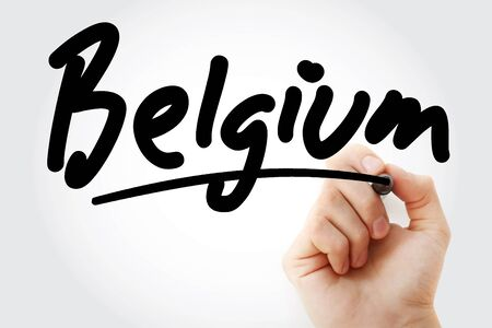 Hand writing Belgium with marker, concept background