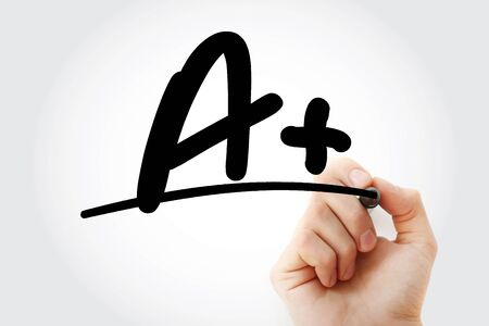 Hand writing education rating A plus with marker, education concept background Фото со стока