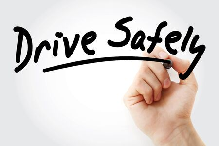 Hand writing Drive Safely with marker, concept background Stock Photo