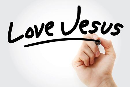 Hand writing Love Jesus with marker, concept background