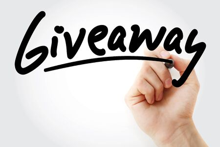Hand writing Giveaway with marker, concept background Zdjęcie Seryjne