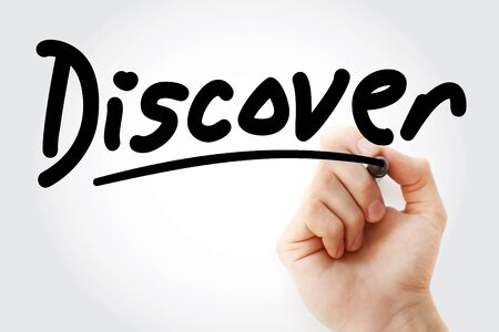 Hand writing DISCOVER with marker, concept background Stock Photo