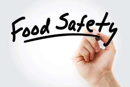 Hand writing Food safety with marker, concept background